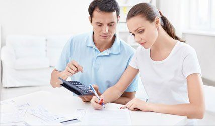 couple using calculator