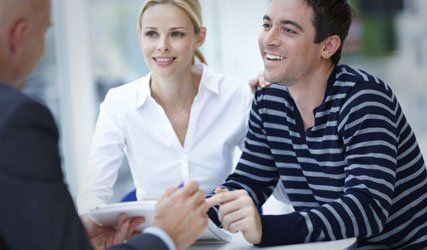 couple in discussion with a loan expert