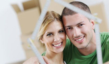 couple in front of boxes