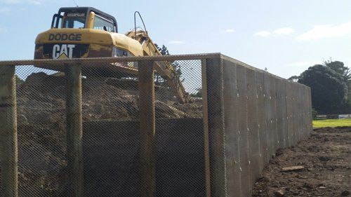 Small track hoe excavator to dig