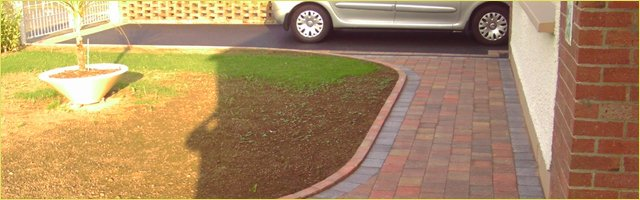 Brick paving, partially grassed lawn area