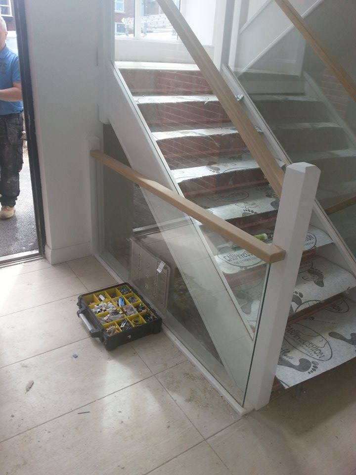 Strong wooden stairs with glass panels