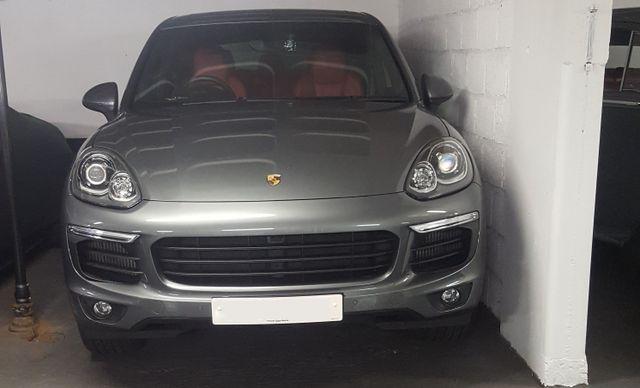 a grey Ferrari car