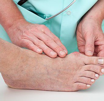 Podiatric doctor diagnosing the feet problem that the patient faces