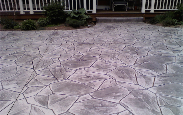 Red stamped concrete patio n backyard
