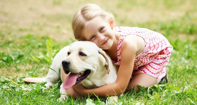 Dog held by a little girl after a visit by our pet doctor in Hinesville, GA