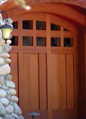 Wooden garage door with arch top glazed panel
