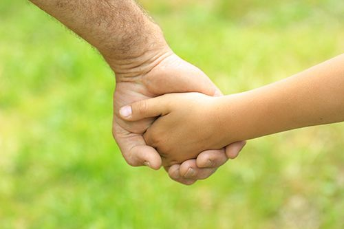Father with his child after seeing Dayton's specialists in family and divorce law