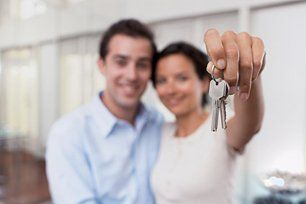 a lady holding the home keys