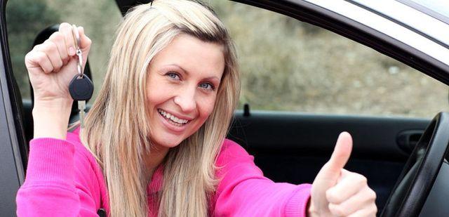 a lady holding the car key