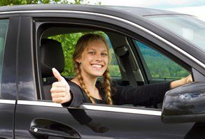a lady showing thumbs up
