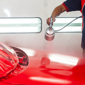 A car being painted bright red