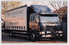 Gibbs Transport black and silver truck
