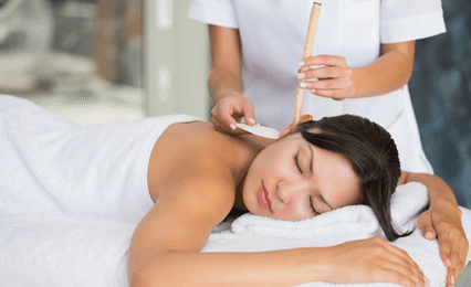 A lady having ear candle therapy