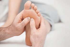 A close up of a reflexology massage