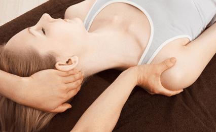 A lady having a neck and shoulder massage