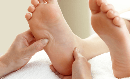 A pair of feet being massaged