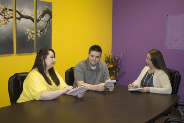 Staff happily working towards client success in St. Charles