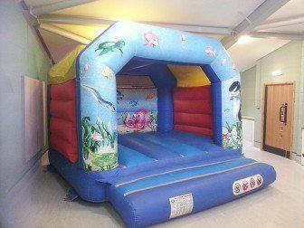 Indoor blue bouncy castle