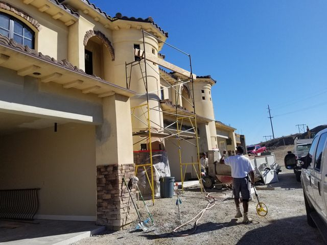 Commercial roofing contractor repairing roofing on a store in Kingman, AZ