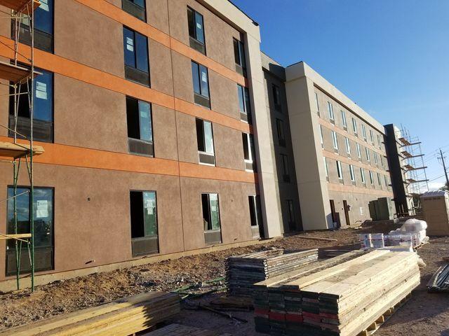 Professional applying concrete stucco to wall in Kingman, AZ