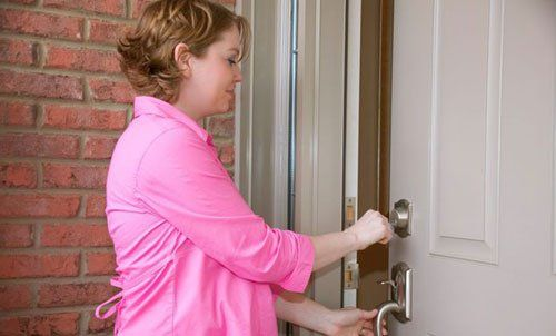 Woman opening lock provided by locksmithing experts in Columbia, MO
