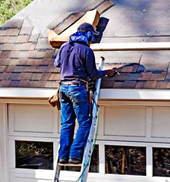 Roofer putting shingles on a roof