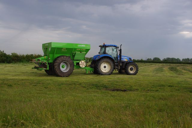 tractor towing a hopper
