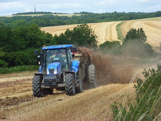 tractor ploughinmg a field