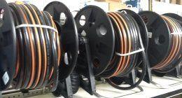 bobine con tubi in plastica per irrigazione
