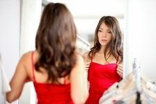 Woman with Low Self Esteem Looking in Mirror