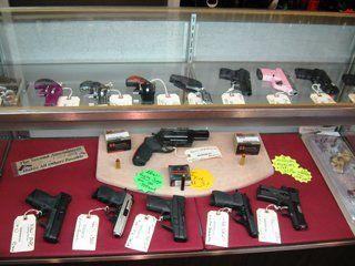 Handguns in a glass case.