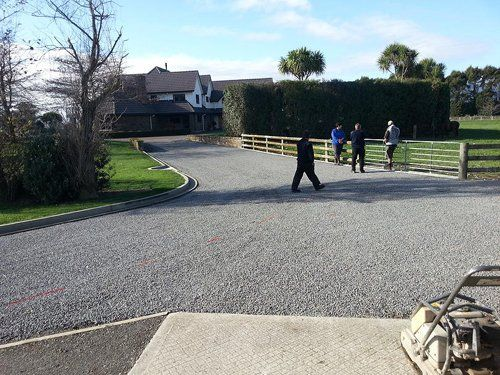People walking on a newly surfaced road