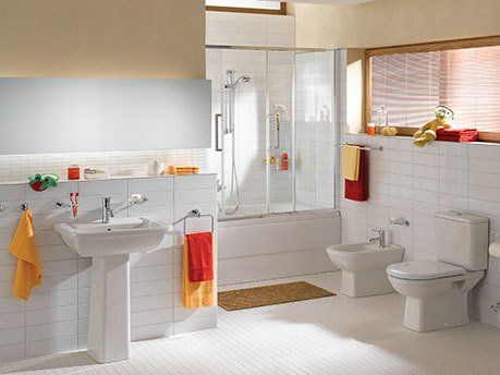 white bathroom designed with tiles from our tile shop