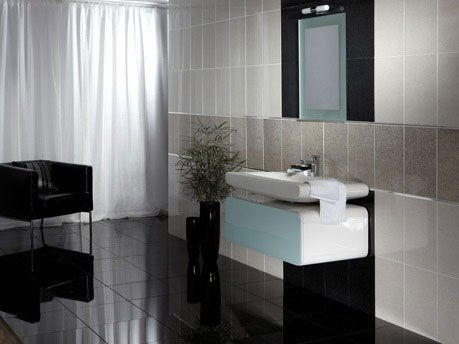 modern bathroom with sink and tile wall