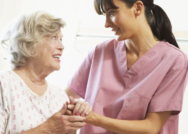 A nurse providing aged care with a resident in Auckland
