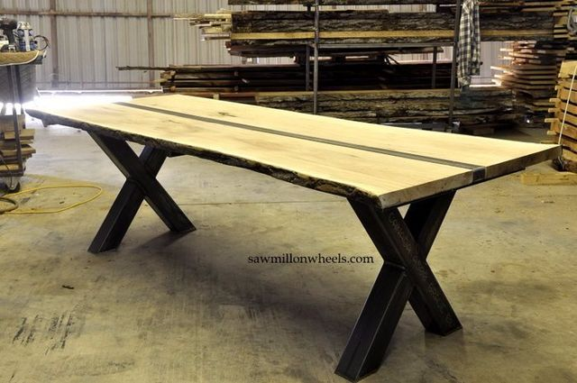 Industrial steel table with live edge slab wood top. Made at sawmill on wheels live edge shop.