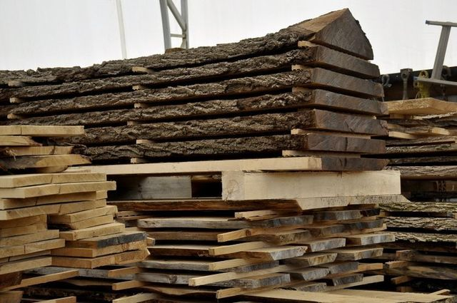 stack of Maple and Black Walnut lumber cut on mobile sawmill