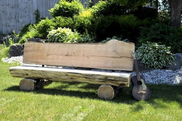 Log bench made in the Sawmill On Wheels live edge shop.