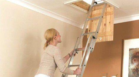 A person using a loft ladder