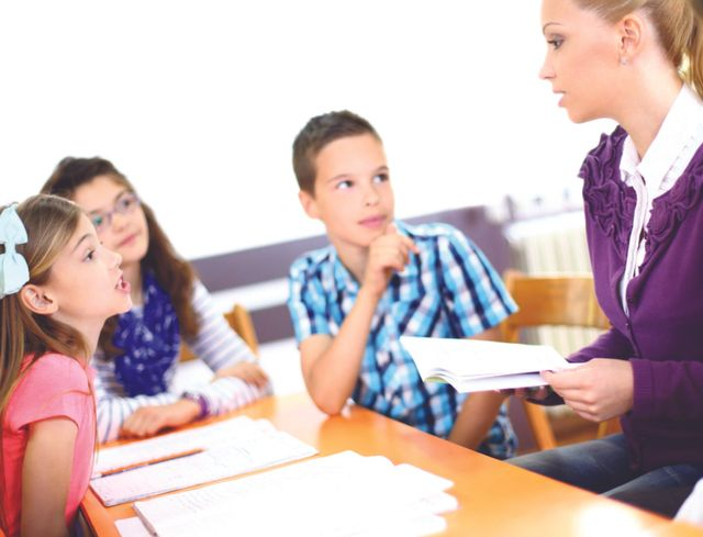 tutor working with small group of children