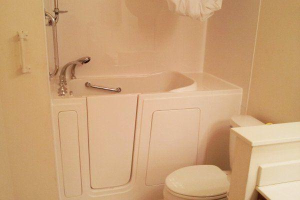 Handicap accessible showers in bathtubs