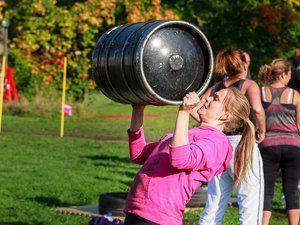 woman lifting  a heavy barrel